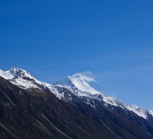 Mt Cook with jet plane clouds passing by. Probably took that cloud 2 seconds to pass by.