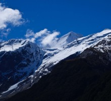 Mt Aspiring can be seen through the clouds. This day it was gale force winds up there.